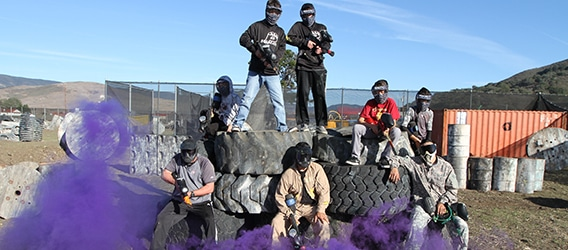 Photo of paintball group standing on tires