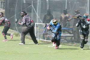 Photo of paintball players running at start of game