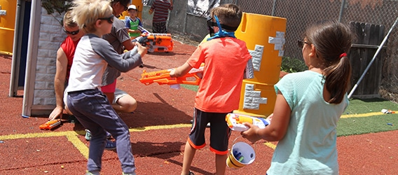 Photo of kids playing Nerf Wars