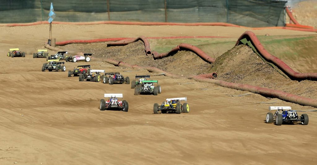 Photo of RC cars racing on dirt track