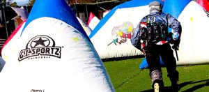 Photo of paintball player running away