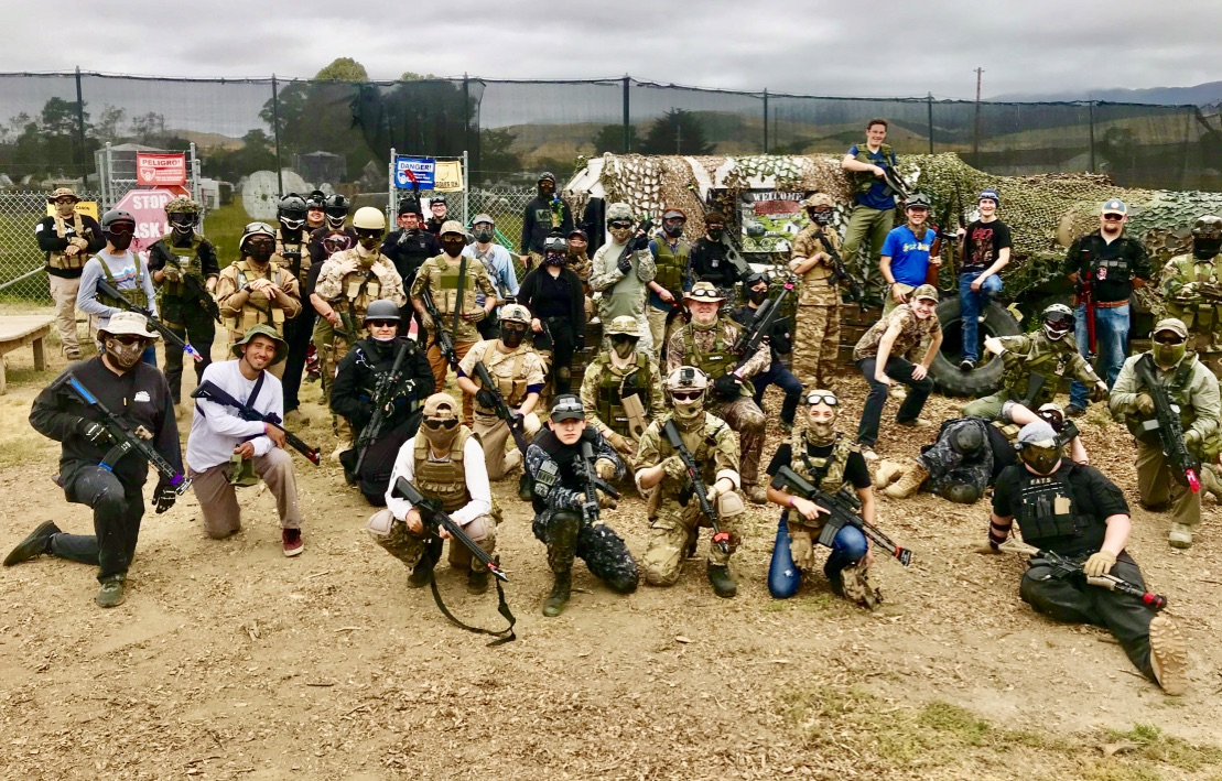Photo of large group of paintball players
