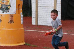 Photo of boy playing Nerf Wars