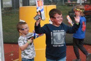 Photo of boy with hands up playing Nerf Wars