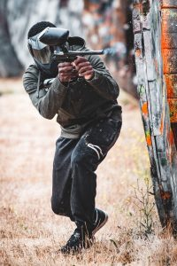 Photo of paintball player firing his marker